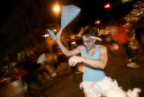 (CS0299) Adam Sikorski takes part in a pillow fight at the intersection of 15th and Larimer along...