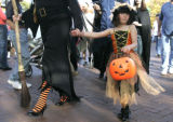 Tasi Moskowitz walks with her stepmother Janet Scheer as they  Trick-or-Treated  on the  Pearl...