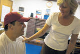 SH08J250STROKESURVIVOR Oct. 29, 2008 -- Ken Knowles works with physical therapist Suzanne...