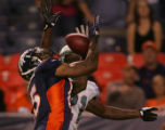 (CS1464) Andre Goodman breaks up a pass intended for Brandon Marshall in the fourth quarter of the...