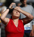30 year-old Amber Crews (cq) from Illinois, cools herself with bottled water after finishing the...