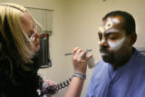 Mike Pearson gets his zombie makeup done in a trailer by makeup artist Midian Crosby (cq) in the...