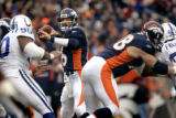 (DENVER, Co., SHOT 1/2/2005) The Denver Broncos' Jake Plummer (#16, QB) drops back to pass during...