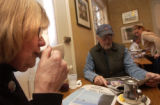(Aspen, Colo., December 29, 2004) Catherine Downey, left, sips her tea as her husband Bud Downey,...