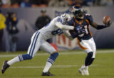 (DENVER, CO., JANUARY 02, 2005) Denver Broncos' #31, Kelly Herndon, right, just misses an...