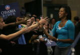 MJM1879  Michelle Obama greets the crowd before speaking to a packed gymnasium at Dakota Ridge...