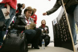 Palin supporter Debi Williamsen (cq) from Niwot, left  buys some goods from Heidi Lasher, right...