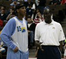 (Denver, CO  on 12/29/2004 ) - Denver Nuggets forward Carmelo Anthony, left, talks to  new Denver...