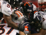(CS056) A gang of Broncos try to brin down Sammy Morris in the 2nd quarter of the Denver Broncos...