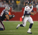 (CS173) Jay Cutler is pursued by the Mike Vrabel in the first quarter of the Denver Broncos...