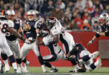 (CS197) Matt Cassel is sacked by Jamie Winborn and Elvis Dumervil in the third quarter of the...