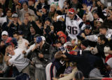 (CS313) Randy Moss leaps into the crowd after his second touchdown in the third quarter of the...