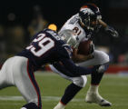 JPM073 Denver Broncos  Nate Jackson is tackled by New England Patriots Lewis Sanders in the first...
