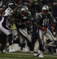 JPM218 Denver Broncos cornerback Dre Bly (32) tries to bring down New England Patriots running...