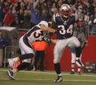 JPM474 Denver Broncos safety Marquand Manuel is dragged into the end zone on a touchdown by  New...