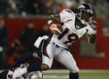 JPM568 Denver Broncos Eddie Royal returns a punt against the New England Patriots in the third...