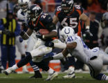 (Shot in Denver, CO  on 01/02/2005 ) - Denver Broncos Tatum Bell, #26,  drags Indianapolis Colts...