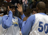 (Denver, CO  on 12/29/2004 ) - Denver Nuggets forward Carmelo Anthony, left, jokes around with...