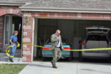 Arapahoe County Sheriff investigators investigate a possible crime scene at 4512 S. Jebel Way in...