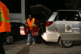 (PG1558) Workers unload final boxes of ballots to the Denver Elections Division on Tuesday night,...