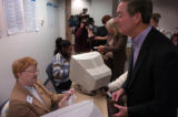 (Littleton., on Sun. Oct. 21 2004) Colorado Gov. Bill Owens, right, kiddingly asks poll worker Nan...