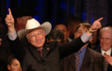 U.S. Senator-elect Ken Salazar smiles and flashes a thumbs-up to supporters after his opponent...