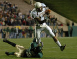 (Fort Collins, CO., OCTOBER 22, 2004)  Wyoming quarterback, #17, Corey Bramlet, breaks the tackle...