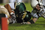 (LAKEWOOD, CO., OCTOBER 22, 2004)  Colorado State's #80, Kory Sperry, left, falls on a Rams'...