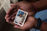 (Colorado Springs, Colo., October 21, 2004) Reggie Matthews holds a picture of his mother Staff...