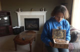 (Aurora, Colo., Oct. 19, 2004) -- Mikayla McCoy, 13, looks at a copy of the Koran her mother got...