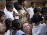 (1/17/05,Kaalapet, India)   Deb Lake, from Michigan, talks with children at the Kaalapet Medical...