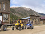 Jim Bushnell, left (in yellow) and George Hoffman, right, ride their ATVs in St. Elmo, a Colorado...