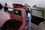 (L-R Jesus Alverado (cq)  trie to gain access to his trunk through the back seat after being ...
