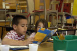 (DENVER, Colo., April 14, 2005) left in red and white stripes, Hector Gonzalez reads with his...
