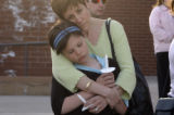 (DENVER, Colo., April 14, 2005) Diana Goldberg, child advocacy worker, holds her daughter Kaila...