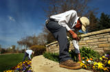 (LT. TO RT.) American Civil Constructors landscapers Moises Flores (cq), 19, and Omar Rosas (cq),...