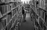 (DENVER, COLO.,  APRIL 12, 2005) Metro State student, Arlene, looks for books at the Auraria...