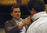 (DENVER, CO., April 15, 2005)  Director Thaddeus Strassberger adjusts Julian Gavin's (The Duke)...