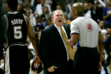 Denver Nuggets head coach George Karl yells at NBA referee Leon Wood during the first half of game...
