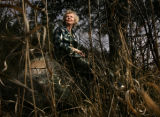 (Estes Park shot on 4/13/05) Marilyn Heller (CQ-Marilyn Heller) stands nears a plaque that...