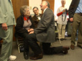 (FT MORGAN, Colo., May 2, 2005) United States Senator Ken Salazar, kneels down to speak with Hazel...