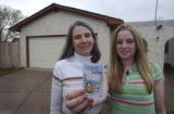 Marcia Barber, who is visually impaired, and daughter Julie Barber, 15, stand on the empty...