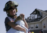 (Superior, Colo., April 17, 2005) Melanie Pray, a firefighter with Boulder Mountain Fire, holds a...