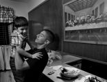 (DENVER, COLO.,  APRIL 21, 2005)  Lincoln High School senior, Fabian, cq, 18, picks up his nephew,...