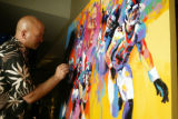 (Denver, Colo., April 16, 2005) Malcolm Farley puts the final touches on a painting for live...