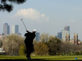 Steve Johnson (cq), of Denver, tees off Tuesday morning May 3, 2005 on the 15th hole at City Park...