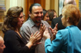 (Lt. to Rt.) Eva Cruz and husband Adrian Cruz, of Denver communicate by sign language with State...