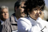 (DENVER, Co. - SHOT 4/19/2005) Sandra Lee Ramirez (left) of Denver wipes away tears during a...