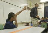 At school P.J. Allen, left, raises his hand in Andre Daughty's classroom on Monday April 18,...