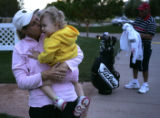 LPGA pro Cathy Johnston-Forbes kisses her, 20-month-old daughter Shannon Sylvia, after the second...